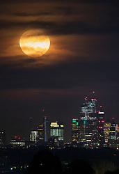 © Licensed to London News Pictures. 14/09/2019. London, UK. A harvest full moon rises over the London Skyline. September's full moon is also a micro moon because it is furthest from Earth on it's eliptical orbit - appearing 14% smaller. Photo credit: Peter Macdiarmid/LNP