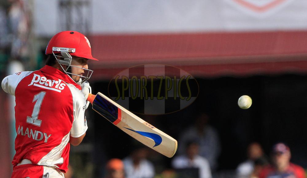 Kings XI Punjab Mandeep Singh plays a shot during match 60 of the Indian Premier League ( IPL ) Season 4 between the Kings XI Punjab and the Delhi Daredevils held at the The HPCA Stadium in Dharamsala, Himachal Pradesh, India on the 15th May 2011..Photo by Pankaj Nangia/BCCI/SPORTZPICS
