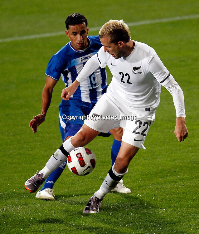 NZ's Jremy Brockie takes on Ivan Guerrero. ASB International Series, All Whites v Honduras, North Harbour Stadium Albany, Saturday 9th October 2010. Photo: Shane Wenzlick