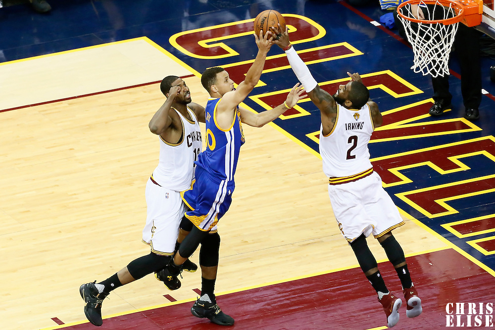 10 June 2016: Golden State Warriors guard Stephen Curry (30) is blocked by Cleveland Cavaliers guard Kyrie Irving (2) during the Golden State Warriors 108-97 victory over the Cleveland Cavaliers, during Game Four of the 2016 NBA Finals at the Quicken Loans Arena, Cleveland, Ohio, USA.