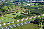 Nederland, Gelderland, Gemeente Neder-Betuwe, 30-09-2015; goederentrein passeert boomgaarden onderweg van Duitsland naar de Haven van Rotterdam op de Betuweroute. Omgeving Ochten, de autosnelweg A15 loopt parallell aan de spoorlijn.<br /> Freight train en route from Germany to the Port of Rotterdam on the Betuweroute.  A15 motorway runs parallell to the railroad.<br /> luchtfoto (toeslag op standard tarieven);<br /> aerial photo (additional fee required);<br /> copyright foto/photo Siebe Swart