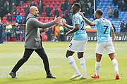 Manchester City Manager Pep Guardiola, Manchester City defender Benjamin Mendy (22) and Manchester City midfielder Raheem Sterling (7) celebrate after the Premier League match between Crystal Palace and Manchester City at Selhurst Park, London, England on 14 April 2019.