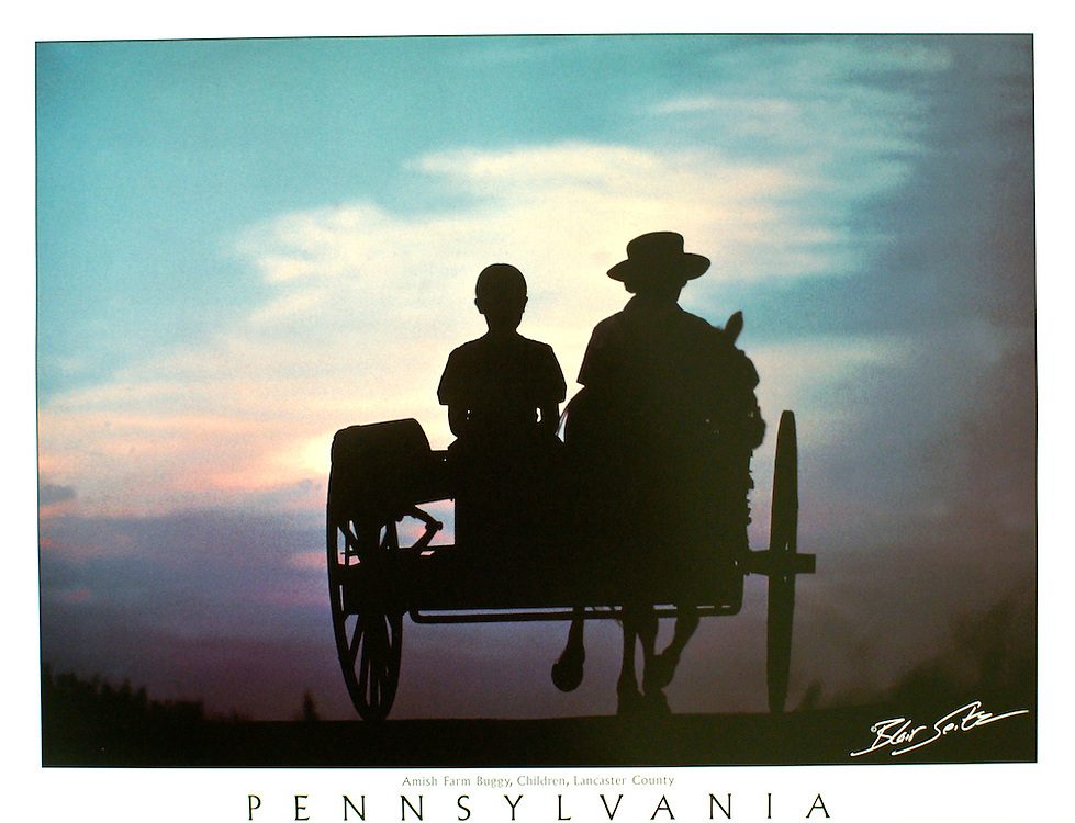 "Poster of Amish children riding in a horse-drawn farm buggy on a Lancaster Co., Pennsylvania road at sunset. White border, with word ""Pennsylvania"" at the bottom with space for frame."