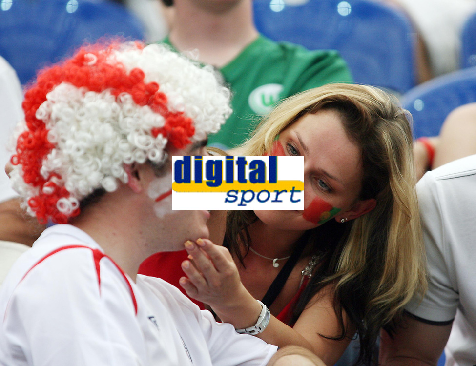 Photo: Chris Ratcliffe.<br /> England v Portugal. Quarter Finals, FIFA World Cup 2006. 01/07/2006.<br /> England fan gets face painted by Portuguese fan.