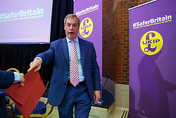 © Licensed to London News Pictures. 29/04/2016. London, UK. UKIP Leader Nigel Farage leaving the stage after delivering a speech on EU referendum and explains security implications if Britain stays in the EU at the Emmanuel Centre in London on Friday, 29 April 2016. Photo credit: Tolga Akmen/LNP