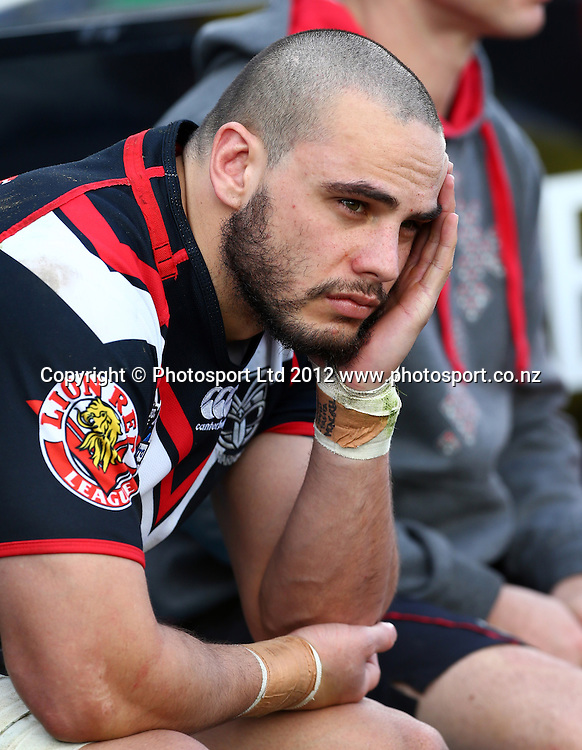 Steve Rapira sits dejectedly on the Warriors bench during the NRL game, Vodafone Warriors v Cronulla Sharks, Mt Smart Stadium, Auckland, Sunday 5 August  2012. Photo: Simon Watts /photosport.co.nz