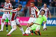 06-03-2016 VOETBAL:WILLEM II-AJAX:TILBURG <br /> Funso Ojo van Willem II in duel met Amin Younes van Ajax en Frank van der Struijk van Willem II <br /> <br /> Foto: Geert van Erven