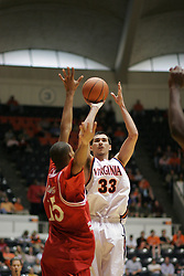 Jason Cain (33) shoots over a Hartford defender.  UVA won 71-62...The Virginia Cavaliers defeated Hartford 71-62 at University Hall in Charlottesville, VA on December 31, 2005.