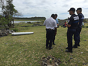 THE REUNION ISLAND, Aug. 6, 2015  <br /> <br /> Debris of missing Malaysian Airlines flight MH370<br /> <br /> Police officers guard the debris on Reunion Island, on Jul.29, 2015. Verification had confirmed that the debris discovered on Reunion Island belongs to missing Malaysian Airlines flight MH370, Malaysian Prime Minister Najib Razak announced early Thursday.©Exclusivepix Media