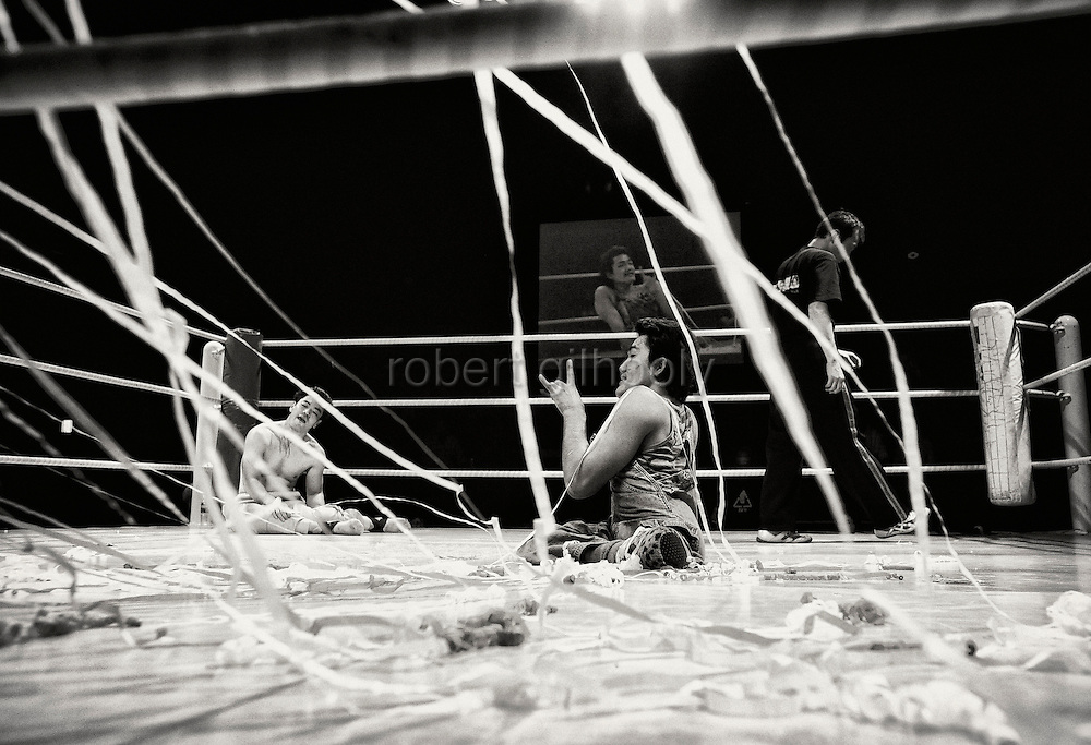 Streamers are thrown onto the ring as the result of a bout is announced during a bout at Doglegs, an event for wrestlers with physical and mental handicaps in Tokyo, Japan.