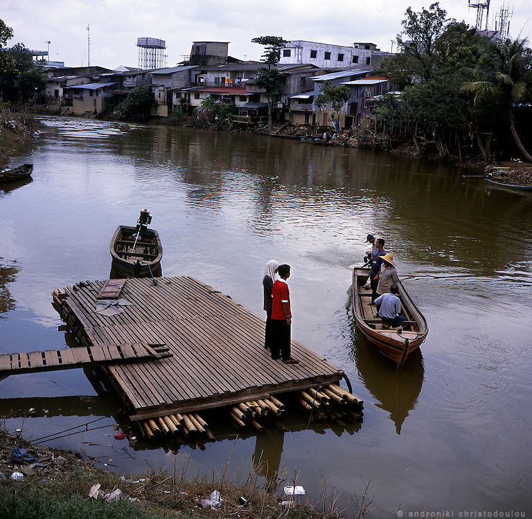 Small boat crossing to Malaysia in Sungai Klolok town on the south border of Thailand. Many people who live near the border in both countries have a special permission to cross back and forth through the border as they have family members in both sides or they need to cross often for their business.