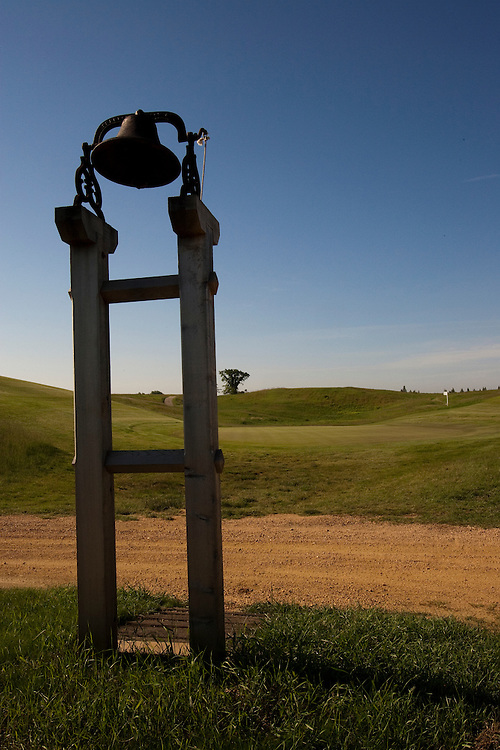 The Erin Hills Golf Course, a rolling and rugged course in Erin, Wisconsin, is home to the 2017 US Open, is well known for the par 3, 7th hole, a green hidden between two slopes. Once play is concluded, a bell is rung to announce the green is open. Please send licensing requests to legal@toddbigelowphotography.com