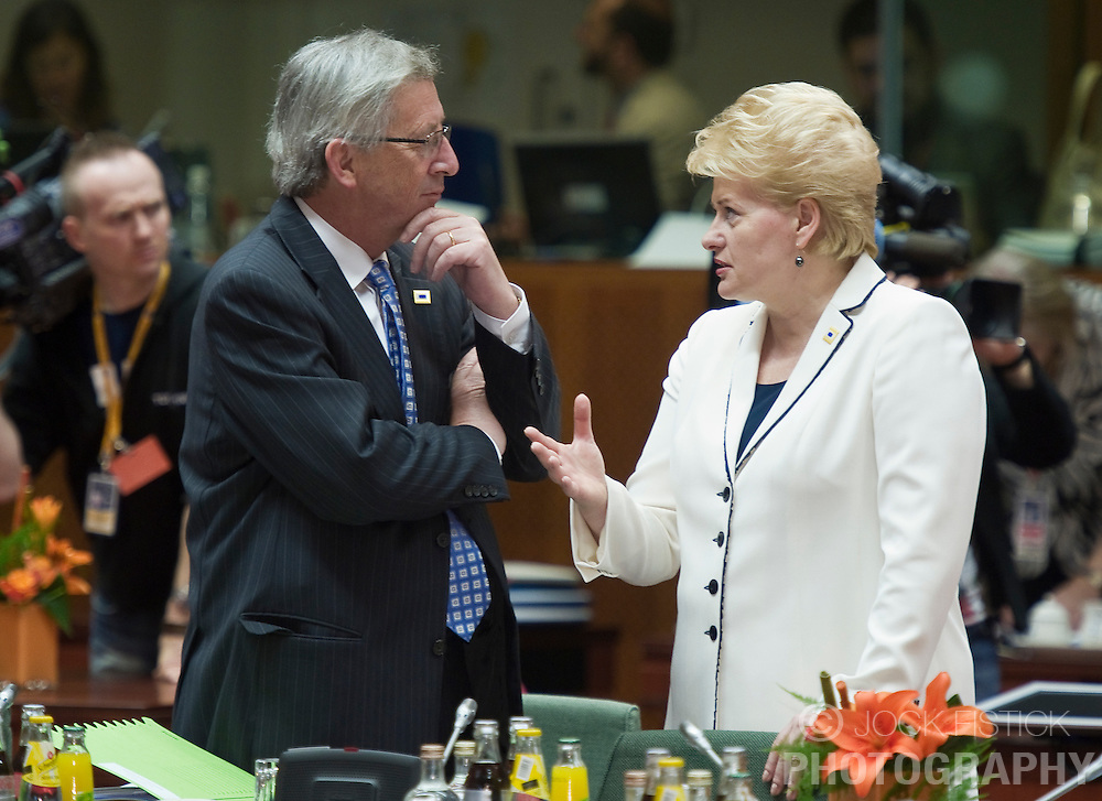 Jean-Claude Juncker, Luxembourg's prime minister, left, speaks with Dalia Grybauskaite, Lithuania's president, during the European Summit meeting at EU Council headquarters in Brussels, Belgium, on Thursday, June 17, 2010. (Photo © Jock Fistick)