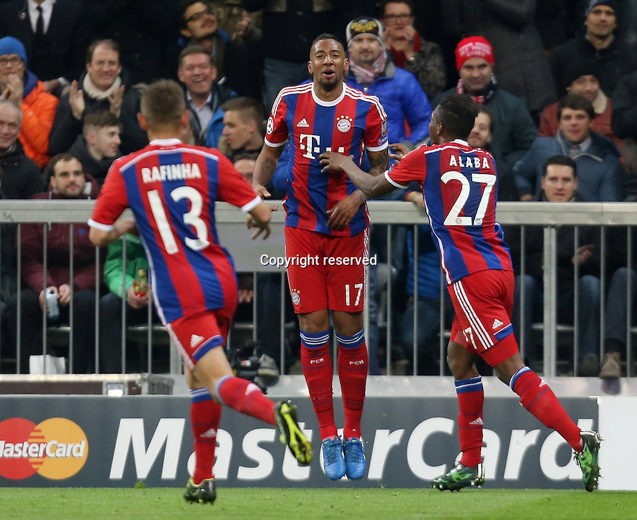 11.03.2015. Allianz Stadium, Munich, Germany. UEFA Champions League football. Bayern Munich versus Shakhtar Donetsk.  Torschutze Jerome Boateng (Bayern) celebrates the goal for 2:0 with Rafinha and David Alaba The game ended 7-0 to Bayern over Shakhtar.