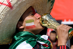 JOHANNESBURG, SOUTH AFRICA - Friday, June 11, 2010: A Mexico supporter with a copy of the World Cup trophy during the opening Group A match against South Africa during the 2010 FIFA World Cup South Africa at the Soccer City Stadium. (Pic by Hoch Zwei/Propaganda)