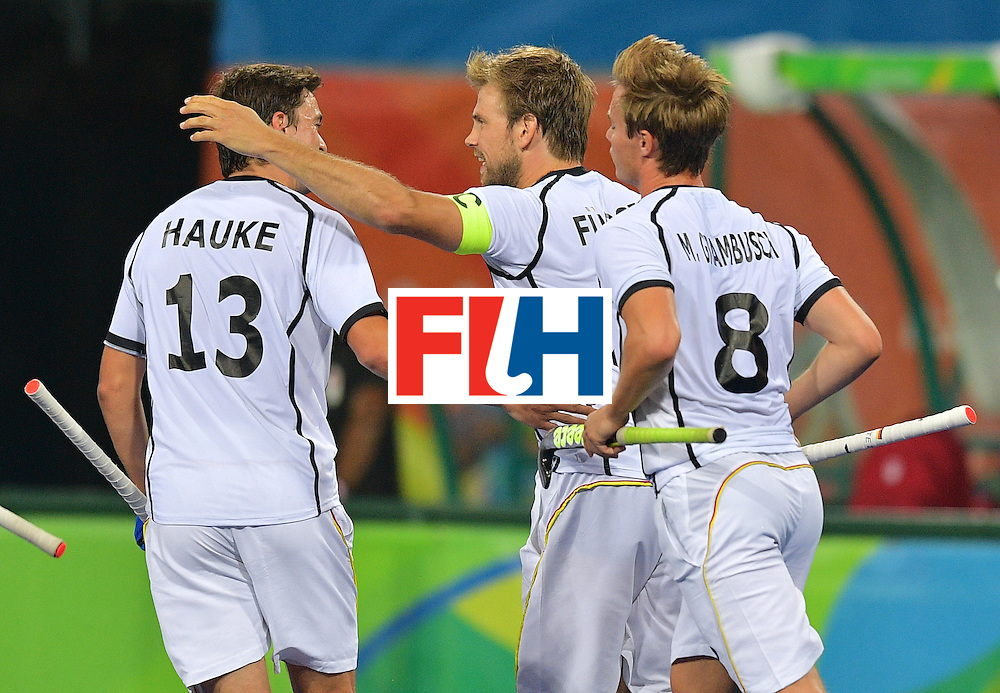German players celebrate a goal during the men's field hockey Canada vs Germany match of the Rio 2016 Olympics Games at the Olympic Hockey Centre in Rio de Janeiro on August, 6 2016. / AFP / Carl DE SOUZA        (Photo credit should read CARL DE SOUZA/AFP/Getty Images)