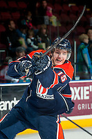 KELOWNA, CANADA -FEBRUARY 1: Collin Shirley LW #15 of the Kamloops Blazers takes a shot during warm up against the Kelowna Rockets on February 1, 2014 at Prospera Place in Kelowna, British Columbia, Canada.   (Photo by Marissa Baecker/Getty Images)  *** Local Caption *** Collin Shirley;