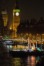 Victoria Embankment, London, January 19th 2017. Police seal off Victoria Embankment near the Houses of Parliament, following the discovery of an unexploded World War II bomb by construction workers. Two of London's busiest stations were temporarily evacuated and both Westminster and Waterloo bridges were closed for a short time. PICTURED: Big Ben towers over the river and the construction barge from which the unexploded bomb appears to have been discovered.