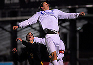 20 NOV. 2010 -- FENTON, Mo. -- Rockhurst High School soccer player Jacob Wilbers (2) soars above St. John Vianney's during a corner in front of the goal defended by the Griffins Paul Scheipeter (9) during the MSHSAA Class 3 soccer championship game at the Anheuser-Busch Center in Fenton, Mo. Saturday, Nov. 20, 2010. Rockhurst won the title, beating Vianney 3-1. Image © copyright 2010 Sid Hastings.