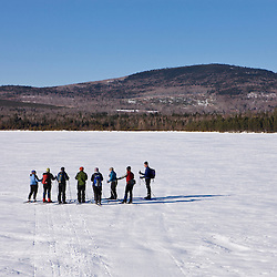 Cross-country skiers on Second Roach Pond near Medawisla Wilderness Camps near Greenville, Maine.