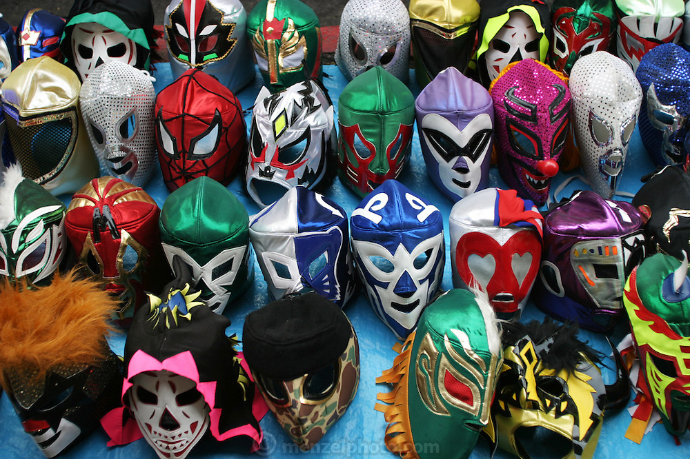 Luchador masks, Cuernavaca, Morelos, Mexico outside the municipal auditorium where wrestling takes place. Wrestling masks.