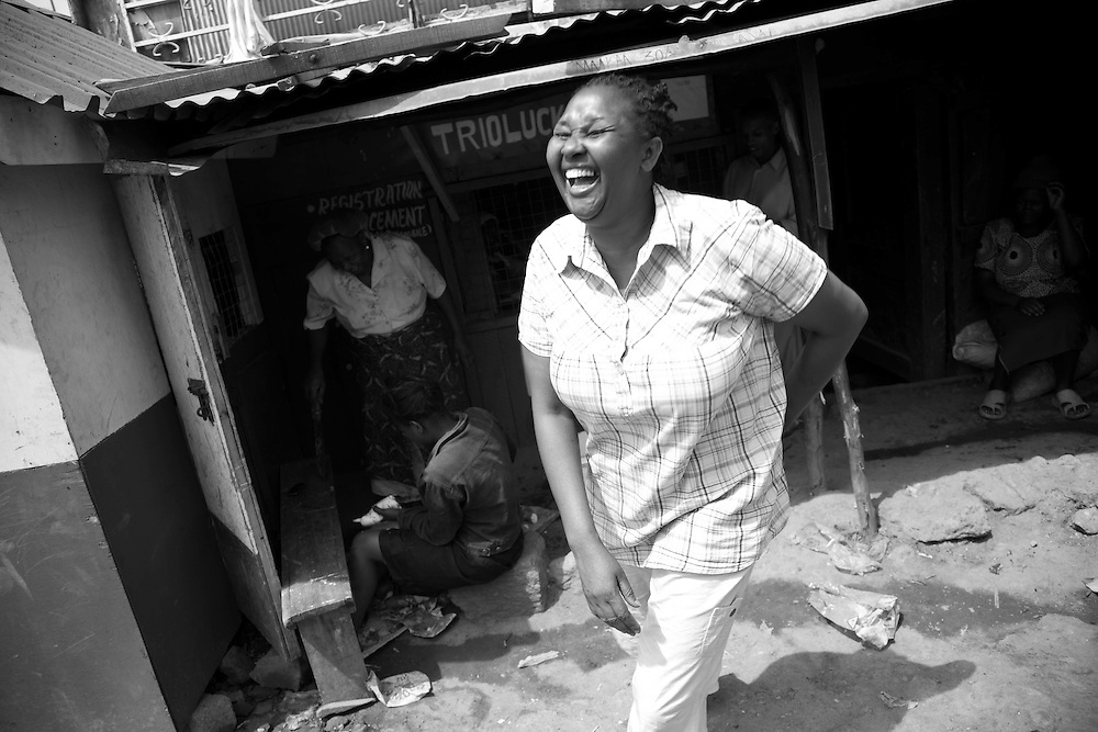 Beatrice seems to put smiles on local resident's faces, as well as her own as we leave one shop in Mathare.