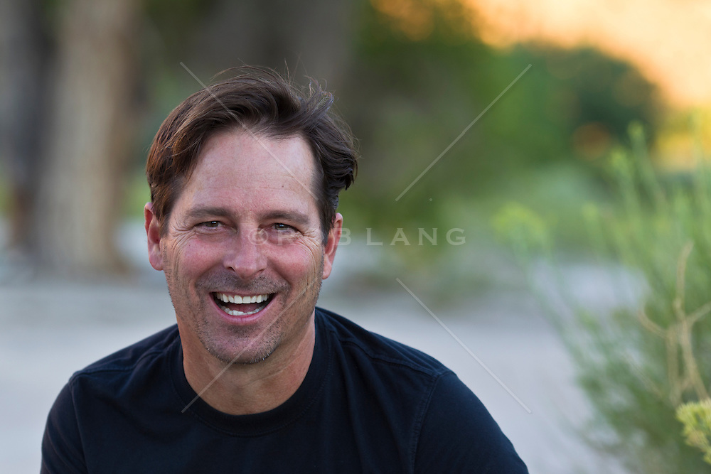 portrait of a good looking forty year old man outdoors