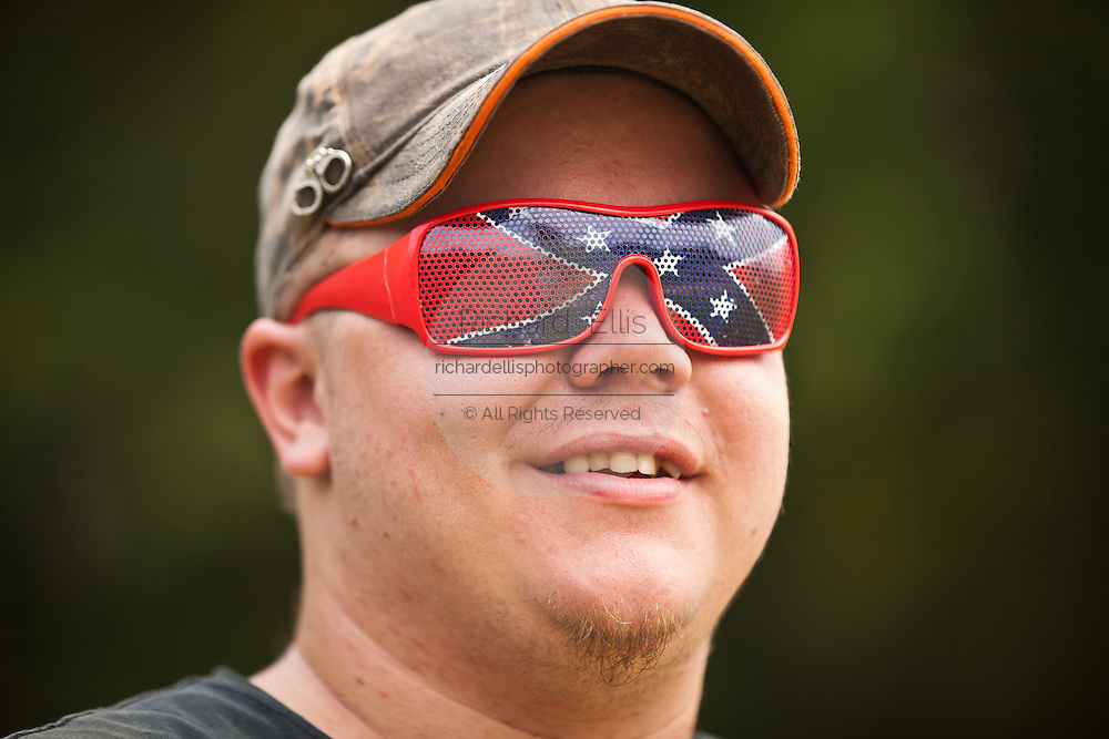 A participant wears confederate sunglasses during the annual Summer Redneck Games Dublin, GA.