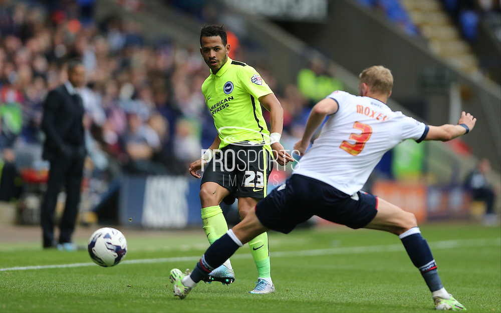 Brighton defender, full back, Liam Rosenior slots the ball past Bolton Wanderers defender Dean Moxey during the Sky Bet Championship match between Bolton Wanderers and Brighton and Hove Albion at the Macron Stadium, Bolton, England on 26 September 2015.