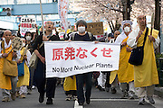 Buddhist priests join around 4,000 people who took part in a demonstration against nuclear power in Tokyo, Japan on  10 April 20011. .Photographer: Robert Gilhooly