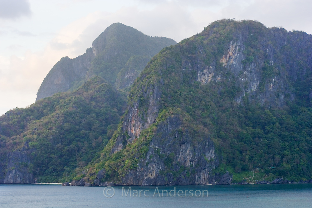 Rugged coastline of limestone outcrops in the Bacuit Archipelago, Palawan, Philippines