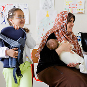 Milan, Italy, May 2008. Centre for immigrant women's health, San Paolo Hospital. An Egyptian mother and her daughters Samar and Rawda during the meeting with the cultural mediator and the pediatrician...Milano, Italia, Maggio 2008. Centro di salute e ascolto donne immigrate, Ospedale San Paolo. Una mamma egiziana con le figlie Samar e Rawda al colloquio di accoglienza con la mediatrice culturale e la pediatra..