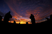 Photo Workshop participants at sunrise, Monument Valley, Navajo Tribal Park, Arizona..Subject photograph(s) are copyright Edward McCain. All rights are reserved except those specifically granted by Edward McCain in writing prior to publication...McCain Photography.211 S 4th Avenue.Tucson, AZ 85701-2103.(520) 623-1998.mobile: (520) 990-0999.fax: (520) 623-1190.http://www.mccainphoto.com.edward@mccainphoto.com