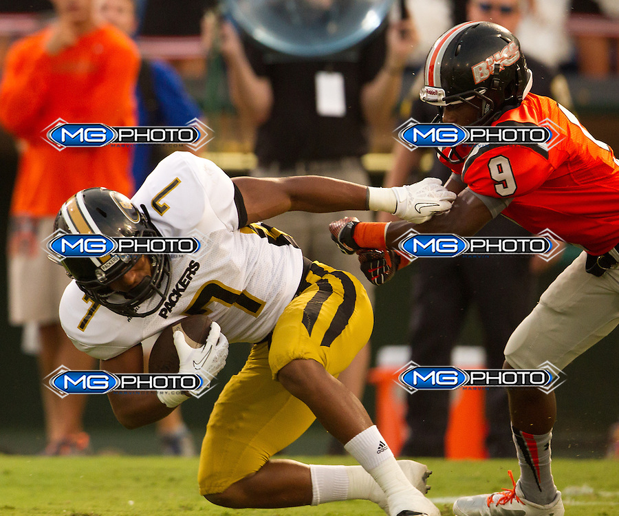 Aug 30, 2013; Hoover, AL, USA; Hoover's Danterrius Buggs (9) grabs Colquitt County's O'Shay Williams  (7). Mandatory Credit: Marvin Gentry