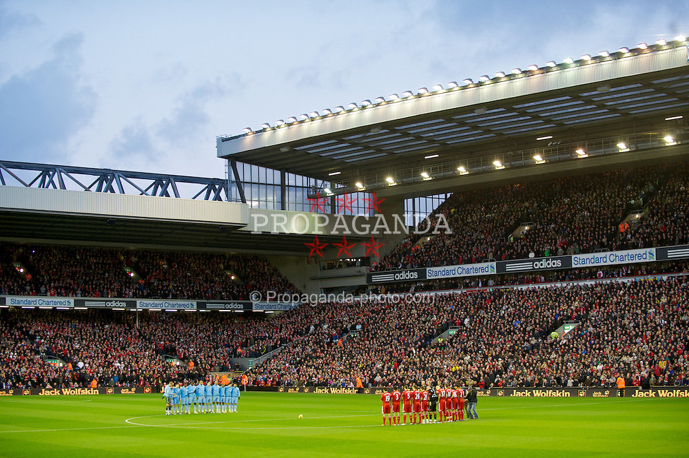 LIVERPOOL, ENGLAND - Sunday, November 27, 2011: Liverpool and Manchester City players stand still for one minute in memory of Liverpool's goalkeeper Brad Jones' son, Luca, and Wales manager Gary Speed, who died this morning, before the Premiership match at Anfield. (Pic by David Rawcliffe/Propaganda)