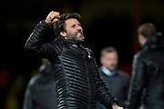 Lincoln City manager Danny Cowley celebrates coming away with 1 point away from home with 9 men during the EFL Sky Bet League 2 match between Swindon Town and Lincoln City at the County Ground, Swindon, England on 12 January 2019.