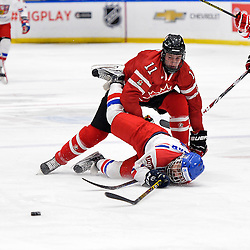 WHITBY, - Dec 16, 2015 -  Game #8 - Czech Republic vs. Canada East at the 2015 World Junior A Challenge at the Iroquois Park Recreation Complex, ON. Sam Dunn #11 of Team Canada East gets called for tripping Marek Zachar #6 of Team Czech Republic during the first period.<br /> (Photo: Shawn Muir / OJHL Images)