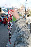 Volunteers collect Olympic pins and display them on a lanyard during the 2010 Olympic Winter Games in Whistler, BC Canada.