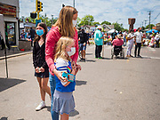 """12 JUNE 2020 - MINNEAPOLIS, MINNESOTA: A girl and her mother at the impromptu memorial for George Floyd at the corner of 38th Street and Chicago Ave. in Minneapolis. The intersection is informally known as """"George Floyd Square"""" and is considered a """"police free zone."""" There are memorials to honor Black people killed by police and people providing free food at the intersection. Floyd, an unarmed Black man, was killed by Minneapolis police on May 25 when an officer kneeled on his neck for 8 minutes and 46 seconds. Floyd's death sparked weeks of ongoing protests and uprisings against police violence around the world.          PHOTO BY JACK KURTZ"""