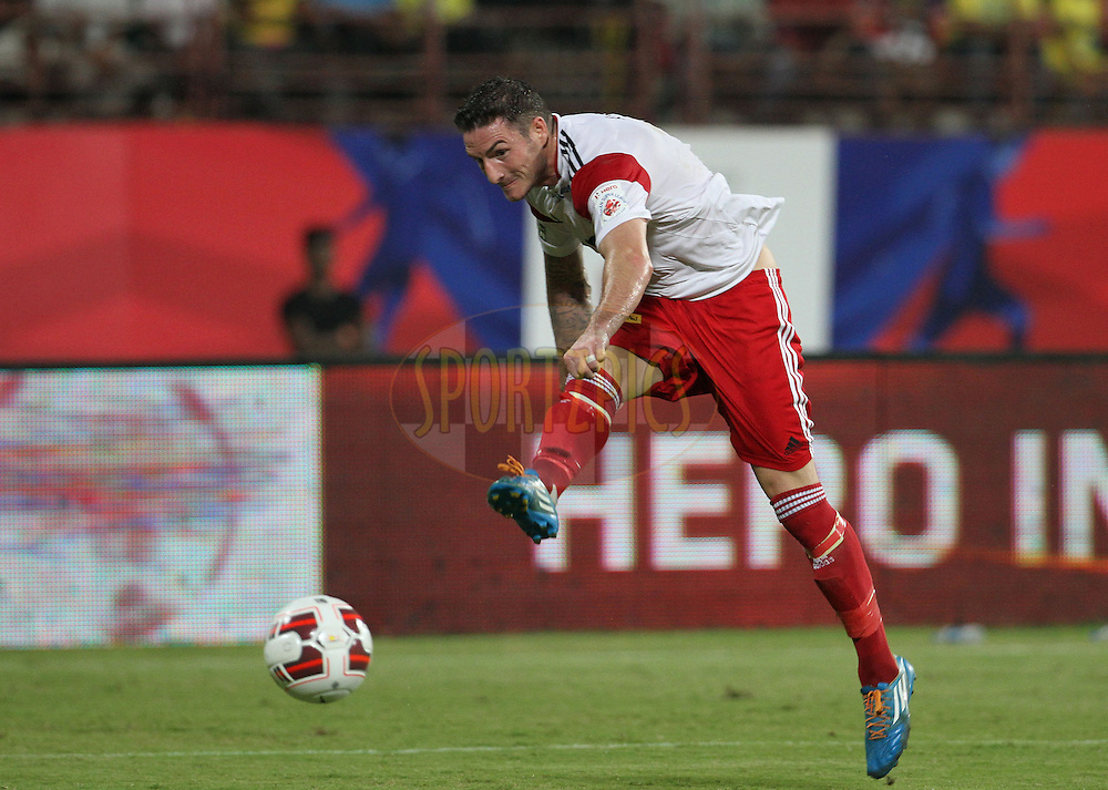 James Keene of NorthEast United FC takes a shot at the goal during match 49 of the Hero Indian Super League between Kerala Blasters FC and North East United FC held at the Jawaharlal Nehru Stadium, Kochi, India on the 4th December 2014.<br /> <br /> Photo by:  Vipin Pawar/ ISL/ SPORTZPICS