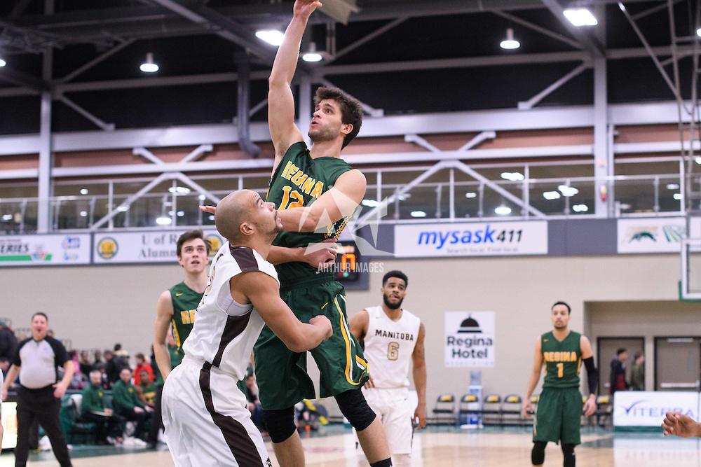 3rd year forward Kornel Tokolyi (12) of the Regina Cougars in action during the home game on January  14 at Centre for Kinesiology, Health and Sport. Credit: /Arthur Images