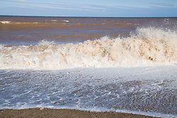 Waves crashing on the beach at Spurn Head; East Yorkshire; which is being eroded by the sea,