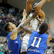 UNCW's Freddie Jackson drives on St. Andrews' defenders Wednesday December 3, 2014 at Trask Coliseum in Wilmington, N.C. (Jason A. Frizzelle)