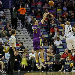 Feb 1, 2016; New Orleans, LA, USA; New Orleans Pelicans forward Ryan Anderson (33) shoots over Memphis Grizzlies guard Vince Carter (15) during the second quarter of a game at the Smoothie King Center. Mandatory Credit: Derick E. Hingle-USA TODAY Sports
