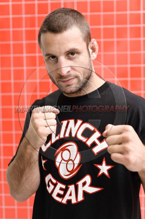 """A portrait of mixed martial arts athlete Tarec """"Sponge"""" Saffiedine"""