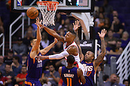 Nov 2, 2016; Phoenix, AZ, USA; Portland Trail Blazers guard Damian Lillard (0) makes a pass against the Phoenix Suns defense during the first half at Talking Stick Resort Arena. The Suns defeated the Trail Blazers 118-115 in overtime. Mandatory Credit: Jennifer Stewart-USA TODAY Sports