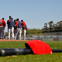 February 19, 2011; Fort Myers, FL, USA; Boston Red Sox infielders huddle up on the mound during spring training at the Player Development Complex.  Mandatory Credit: Derick E. Hingle