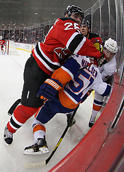 Mar 8; Newark, NJ, USA; New Jersey Devils defenseman Anton Volchenkov (28) hits New York Islanders center Frans Nielsen (51) during the first period at the Prudential Center.
