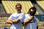LOS ANGELES, CA - JULY 15:  Matisyahu (left) and Koool Kojak ham it up as they get ready to perform a song before the Los Angeles Dodgers game against the San Diego Padres on Sunday, July 15, 2012 at Dodger Stadium in Los Angeles, California. The Padres won the game 7-2. (Photo by Paul Spinelli/MLB Photos via Getty Images) *** Local Caption *** Matisyahu;Koool Kojak