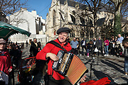 Christian Bassoul, accordionist, playing traditional French songs at Le Petit Bal de la Rue Mouffetard, a street music session held every Sunday morning, encouraging passersby to sing along and dance, at the Place Georges Moustaki, in the 5th arrondissement of Paris, France. Photographed on 17th February 2019 by Manuel Cohen